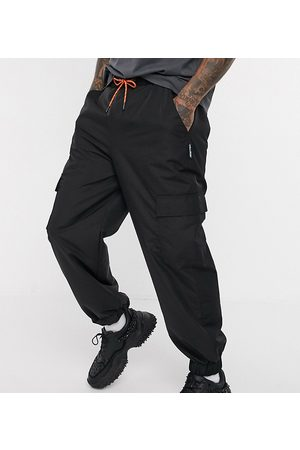 Collusion Nylon cargo pants with pockets in