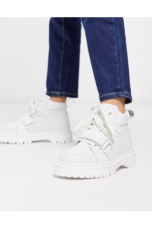 Dr. Martens Zuma with buckle strap flat ankle boots in