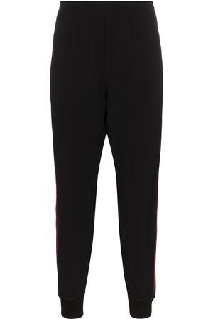 Alexander McQueen Men Sweatpants - Logo tape track pants