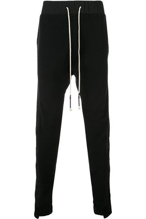 MOSTLY HEARD RARELY SEEN Men Sweatpants - Asymmetrical seam track trousers