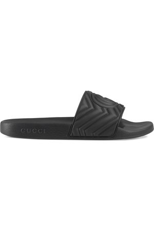 Gucci Double G matelassé slides