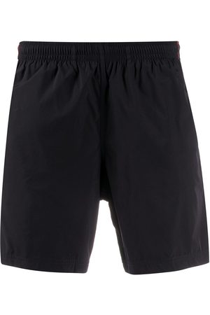 Alexander McQueen Side tape swim shorts