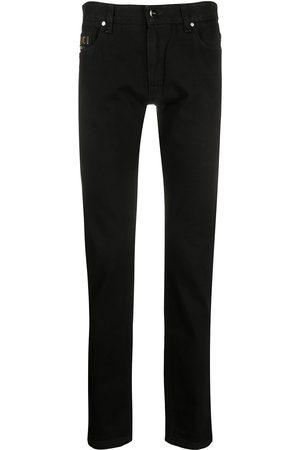 Fendi Embroidered logo slim-fit jeans