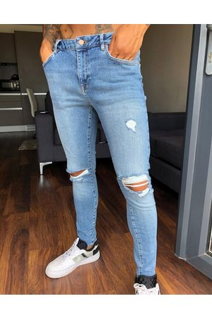 ASOS Skinny - Spray on'vintage look' jeans with power stretch in mid wash with knee rips