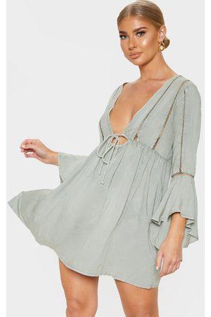 PRETTYLITTLETHING Women Beach Dresses - Pale Khaki Tie Front Frill Sleeve Beach Dress