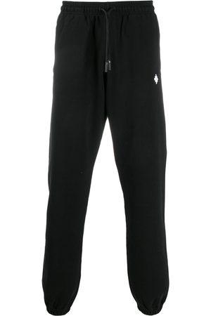 MARCELO BURLON Logo-embroidered drawstring track pants