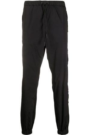 MARCELO BURLON Cross tapered track pants