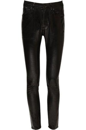 Saint Laurent Coated Cotton Denim Skinny Jeans