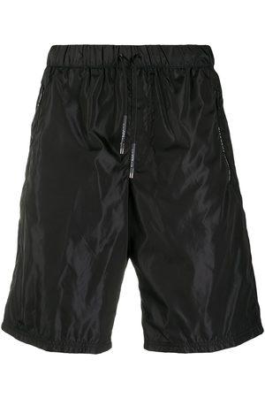 Givenchy Knee-length track shorts