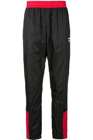 A BATHING APE® Contrast-panel track pants
