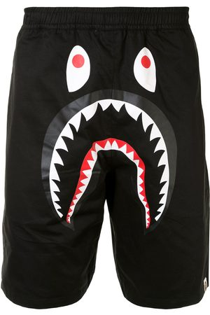 A BATHING APE® Graphic print track shorts