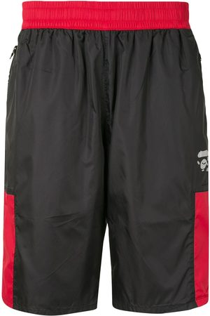 A BATHING APE® Contrast-panel track shorts