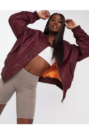 ASOS Oversized bomber jacket with sleeve detail in oxblood