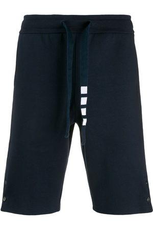 Thom Browne Men Shorts - Side vent 4-Bar track shorts