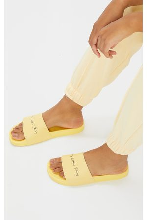 PRETTYLITTLETHING Pale Slogan Sliders