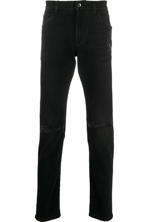 Dolce & Gabbana Embroidered crest slim-fit jeans