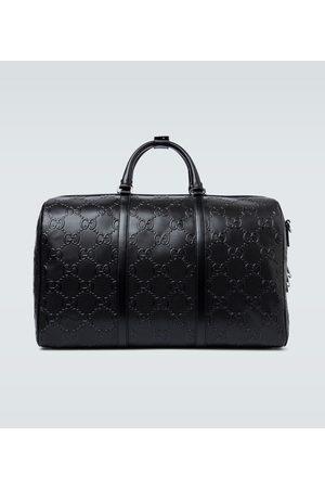 Gucci GG embossed duffle bag