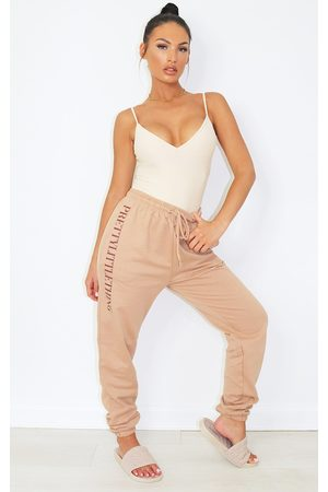 PRETTYLITTLETHING Camel Slogan Joggers