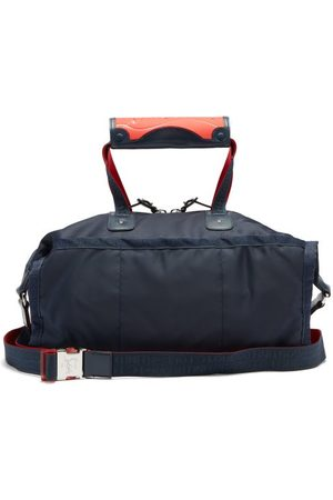 Christian Louboutin Pariscuba Leather-trimmed Holdall - Mens - Navy