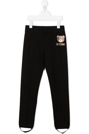 Moschino Teddy logo foot strap leggings