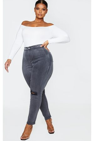 PRETTYLITTLETHING Plus Washed Knee Rip Disco Skinny Jeans
