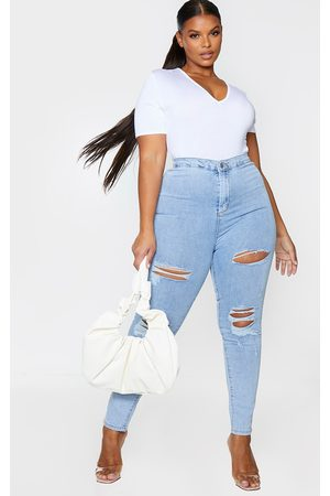PRETTYLITTLETHING Plus Vintage Wash Distressed Disco Skinny Jean