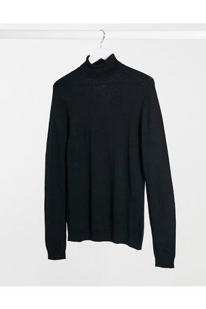 ASOS Muscle fit merino wool roll neck sweater in