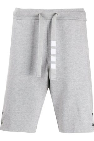 Thom Browne Men Shorts - Side vent 4-Bar track shorts - Grey