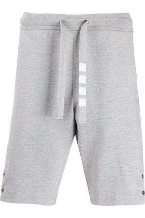 Thom Browne Men Shorts - Side vent 4-Bar track shorts - Grey