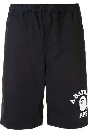 A BATHING APE® Logo-print track shorts
