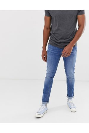 Jack & Jones Intelligence Glenn slim tapered fit jeans in light