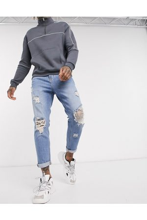 ASOS Tapered carrot jeans in vintage light wash with heavy rips