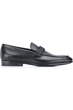 Tod's T-buckle leather loafers