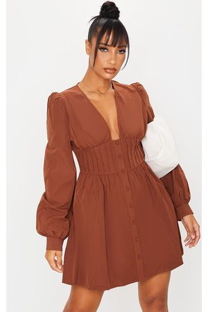 PRETTYLITTLETHING Chocolate Button Front Fitted Puff Sleeve Skater Dress