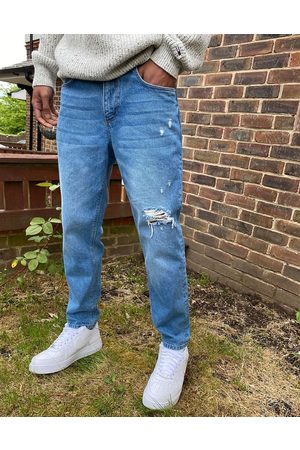 ASOS Classic rigid jeans in mid wash with rips
