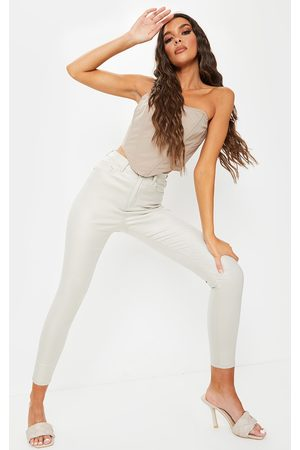 PRETTYLITTLETHING Cream Coated Skinny Jeans
