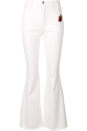 Dolce & Gabbana Sacred Heart patch flared jeans
