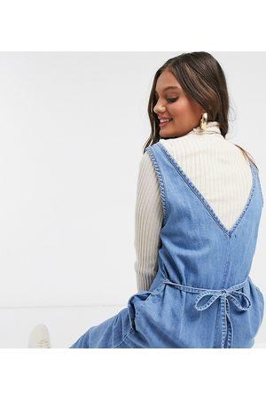 ASOS ASOS DESIGN Petite soft denim slouchy v neck jumpsuit in