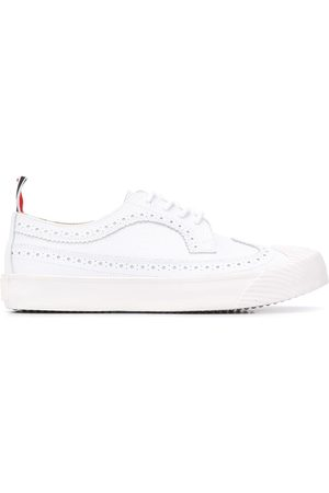 Thom Browne Women Formal Shoes - Longwing pebbled leather sneakers