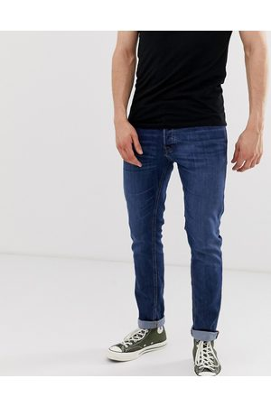 Jack & Jones Intelligence Glenn slim tapered fit jeans in mid