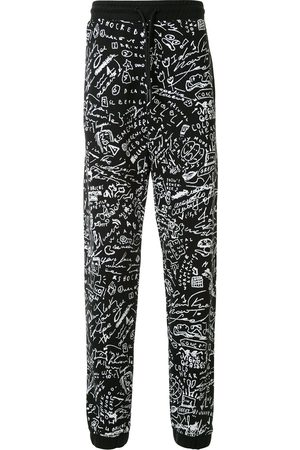 MARCELO BURLON Scribble print track pants
