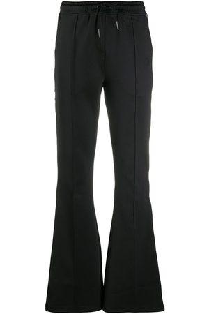 Daily paper Women Sweatpants - Stripe-side flared track pants