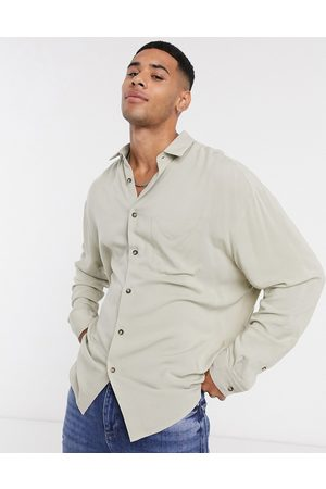 ASOS Oversized fit button collar shirt in viscose in stone