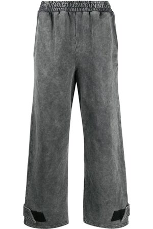 A-cold-wall* Men Wide Leg Pants - Faded wide-leg trousers