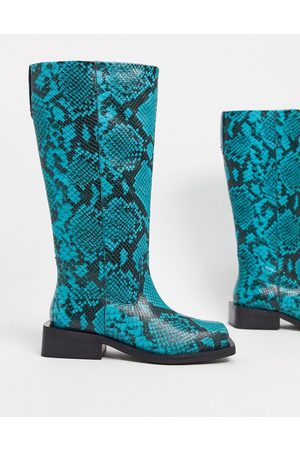 ASOS Charly premium leather trucker knee boots in snake
