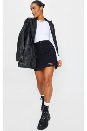 PRETTYLITTLETHING Distressed Rip Denim Mini Skirt