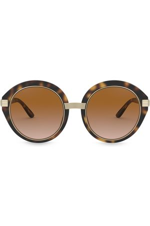 Tory Burch Round frame sunglasses with metal arm