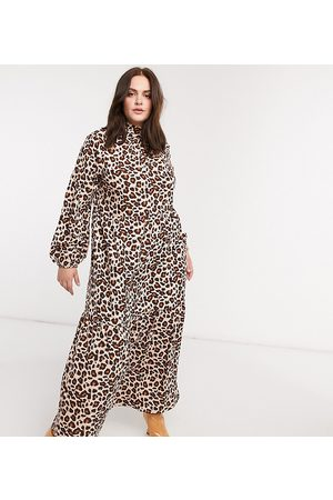 Verona High neck long sleeve dress with tiered skirt in leopard print