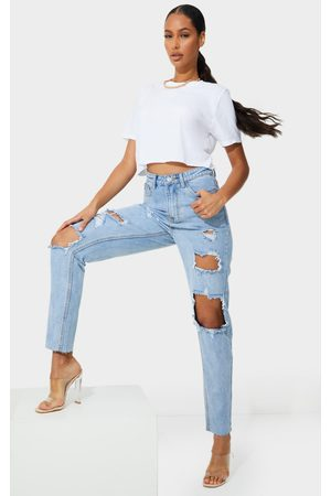 PRETTYLITTLETHING Light Wash Extreme Distressed Slim Fit Mom Jeans