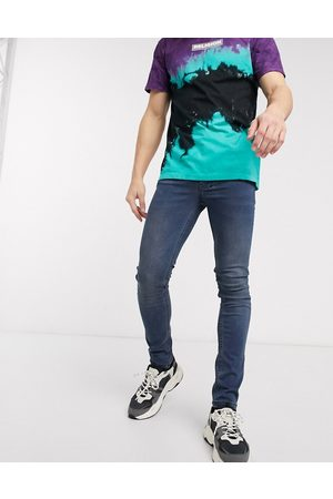 Religion Vicious skinny fit jeans in mid wash